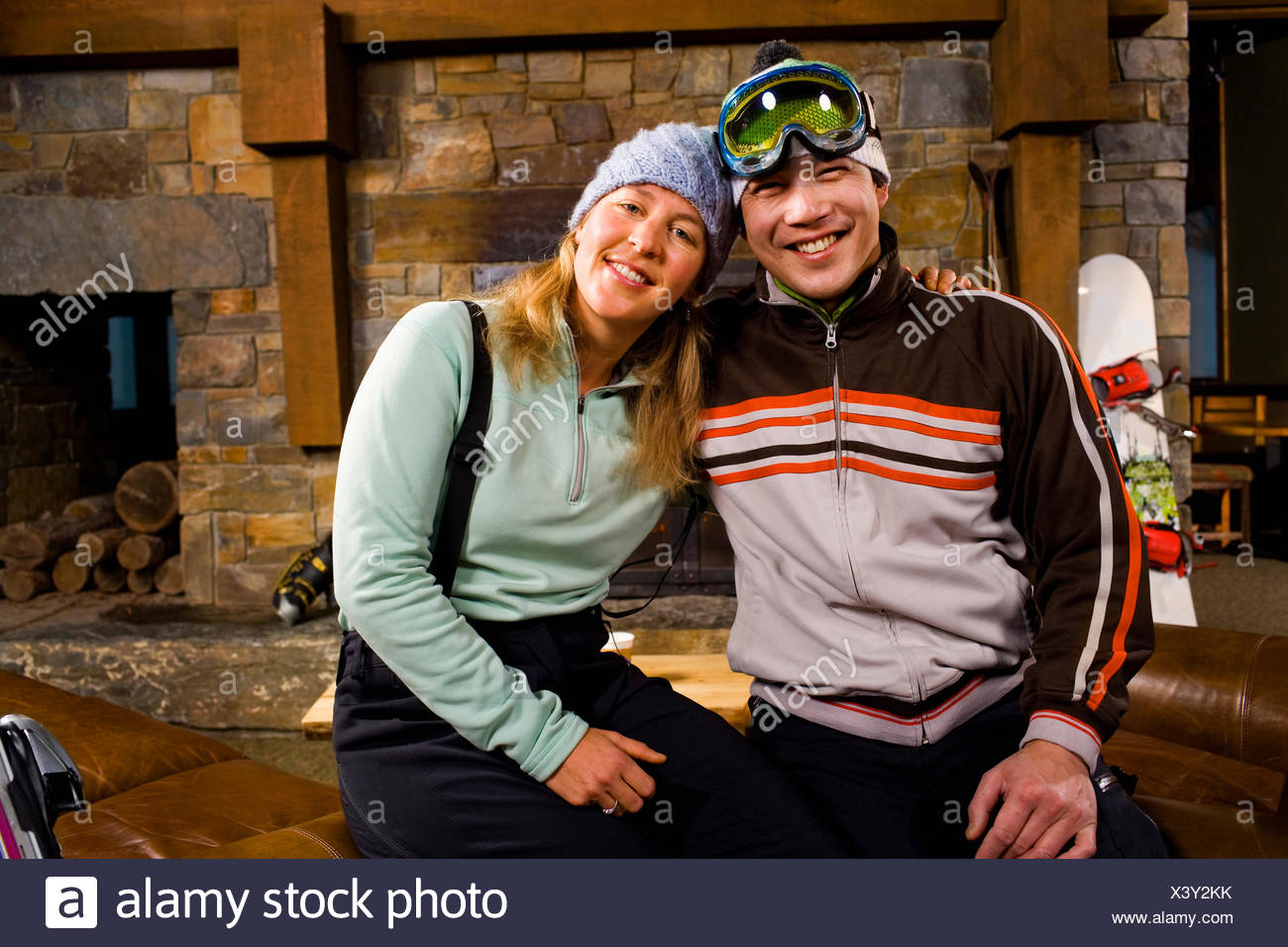 USA, Montana, Whitefish, Portrait of couple in front of fireplace - Stock Image