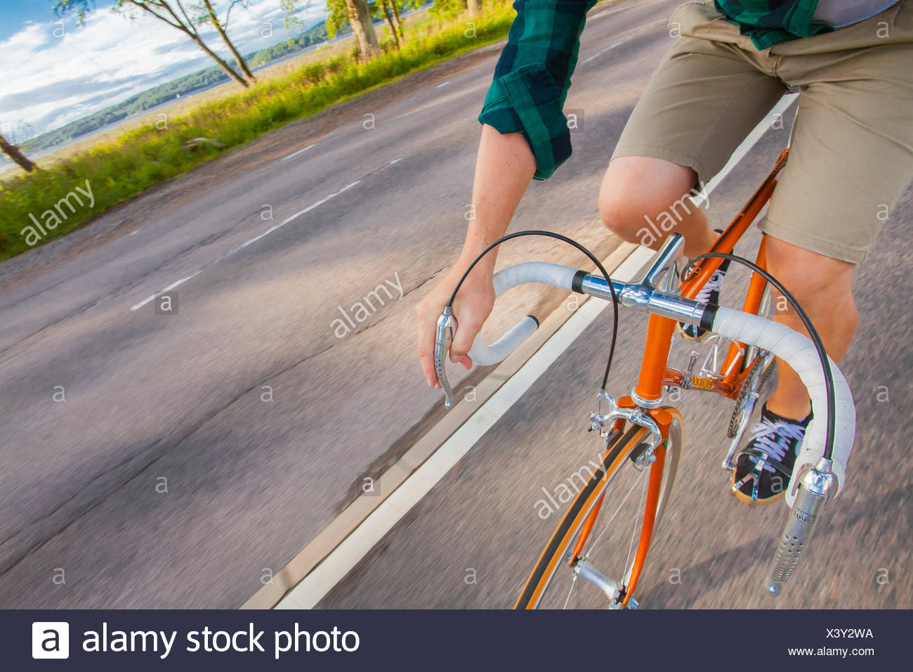 Sweden, Vastergotland, Lerum, Man cycling - Stock Image