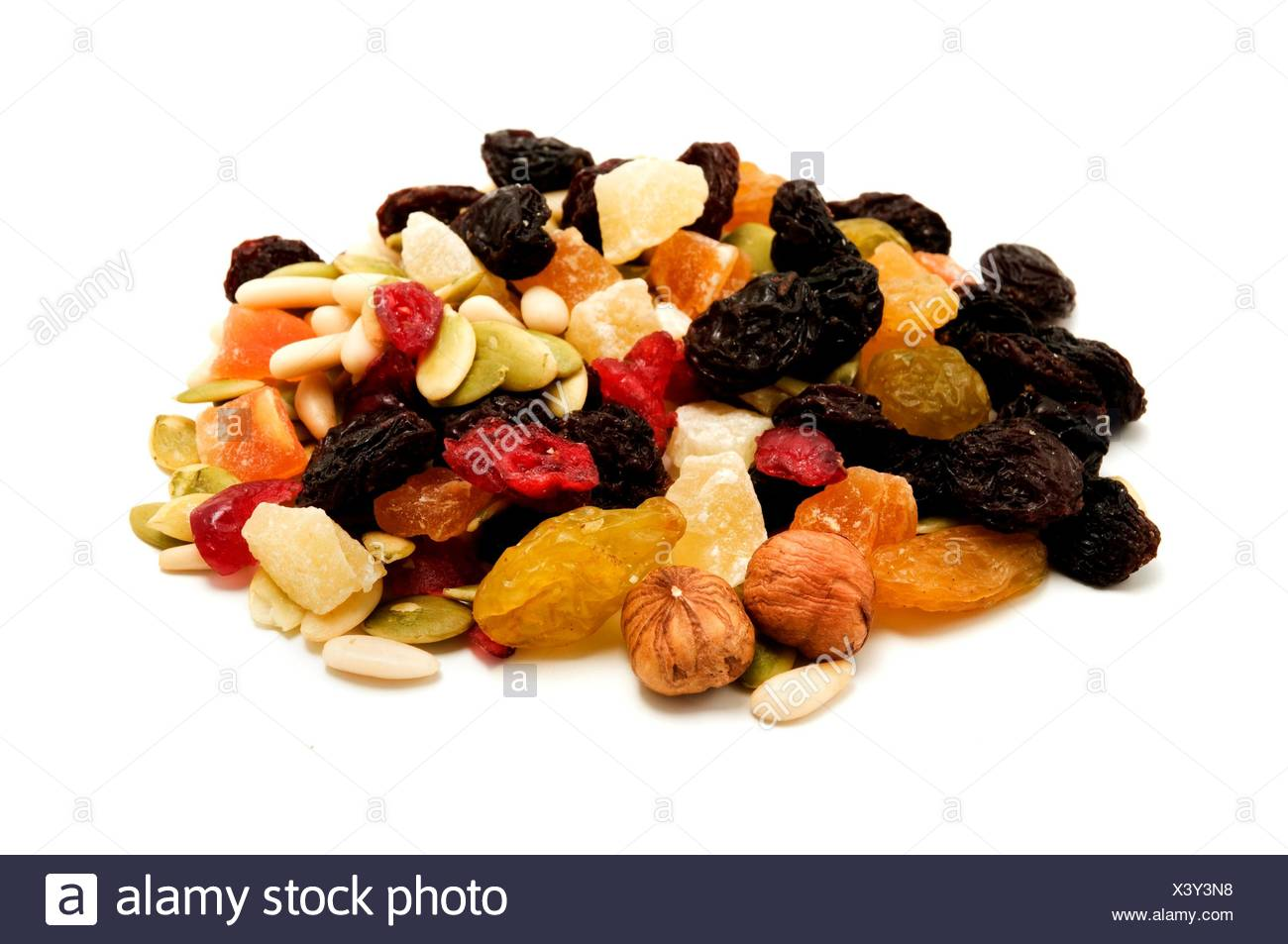 Mixed dried fruits on a white background - Stock Image