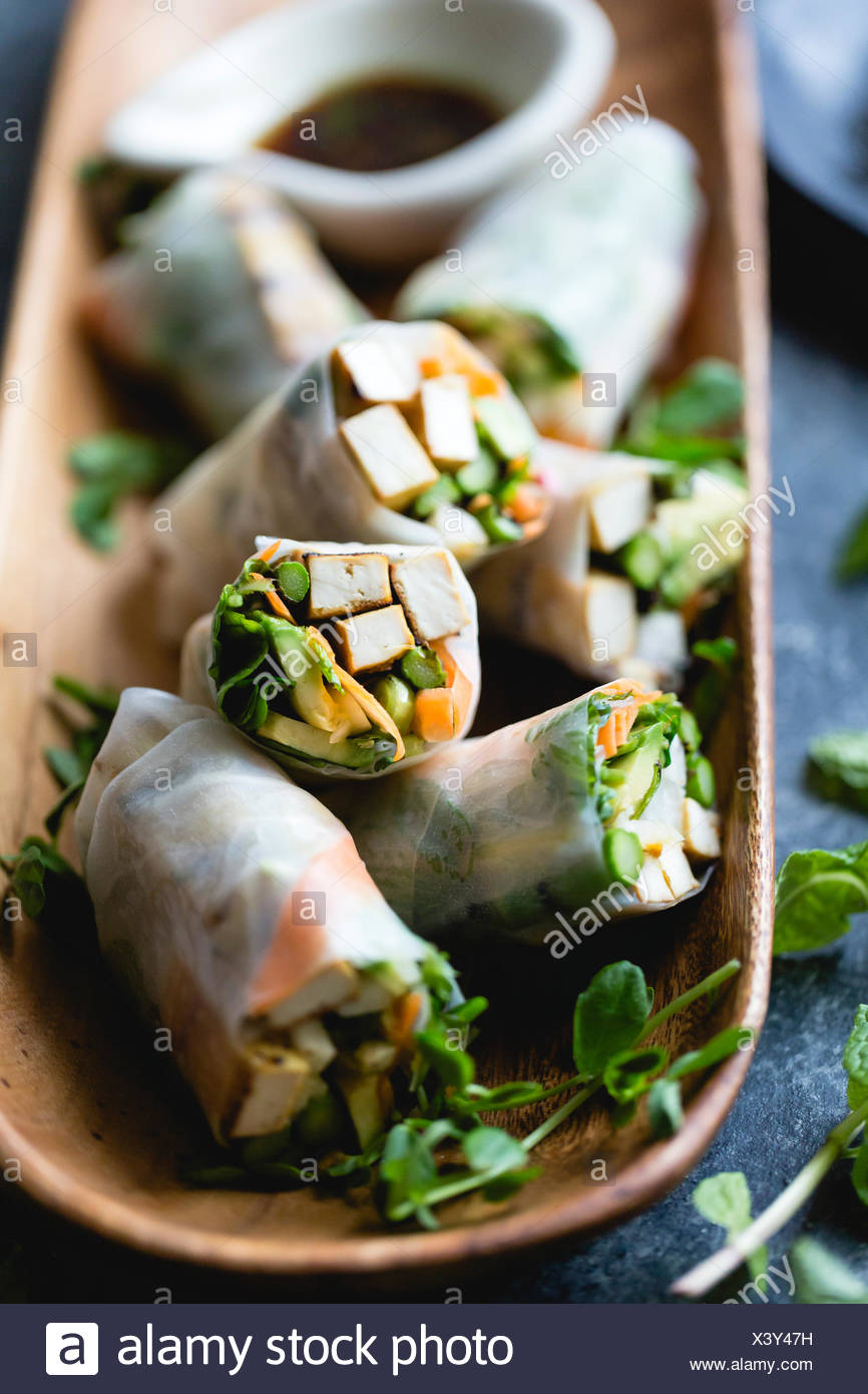 grilled asparagus tofu spring rolls with ginger-lime dipping sauce - Stock Image