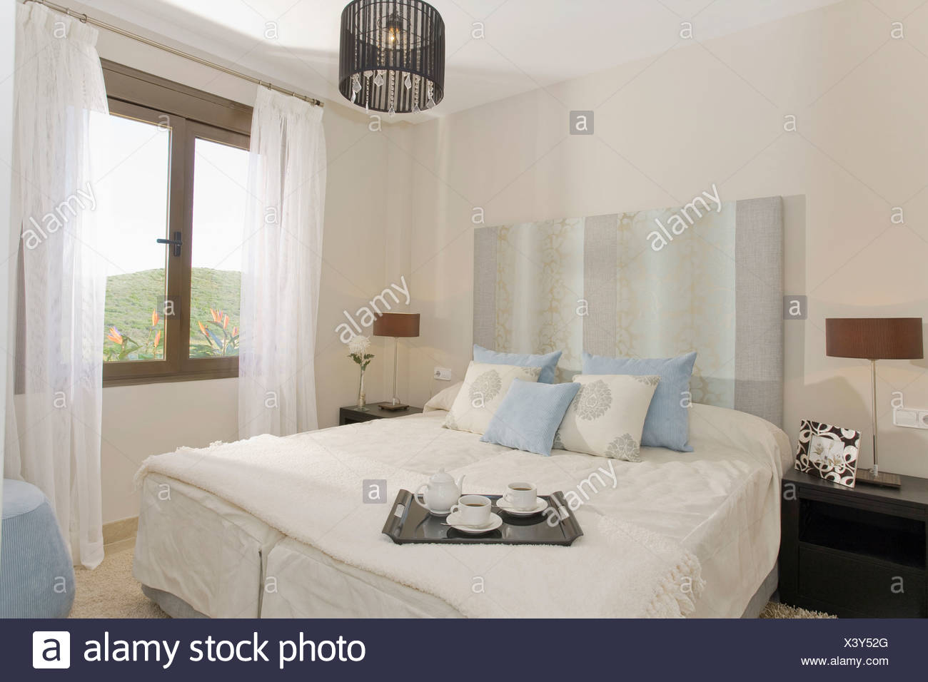 Pale blue striped headboard and pastel blue and cream ...