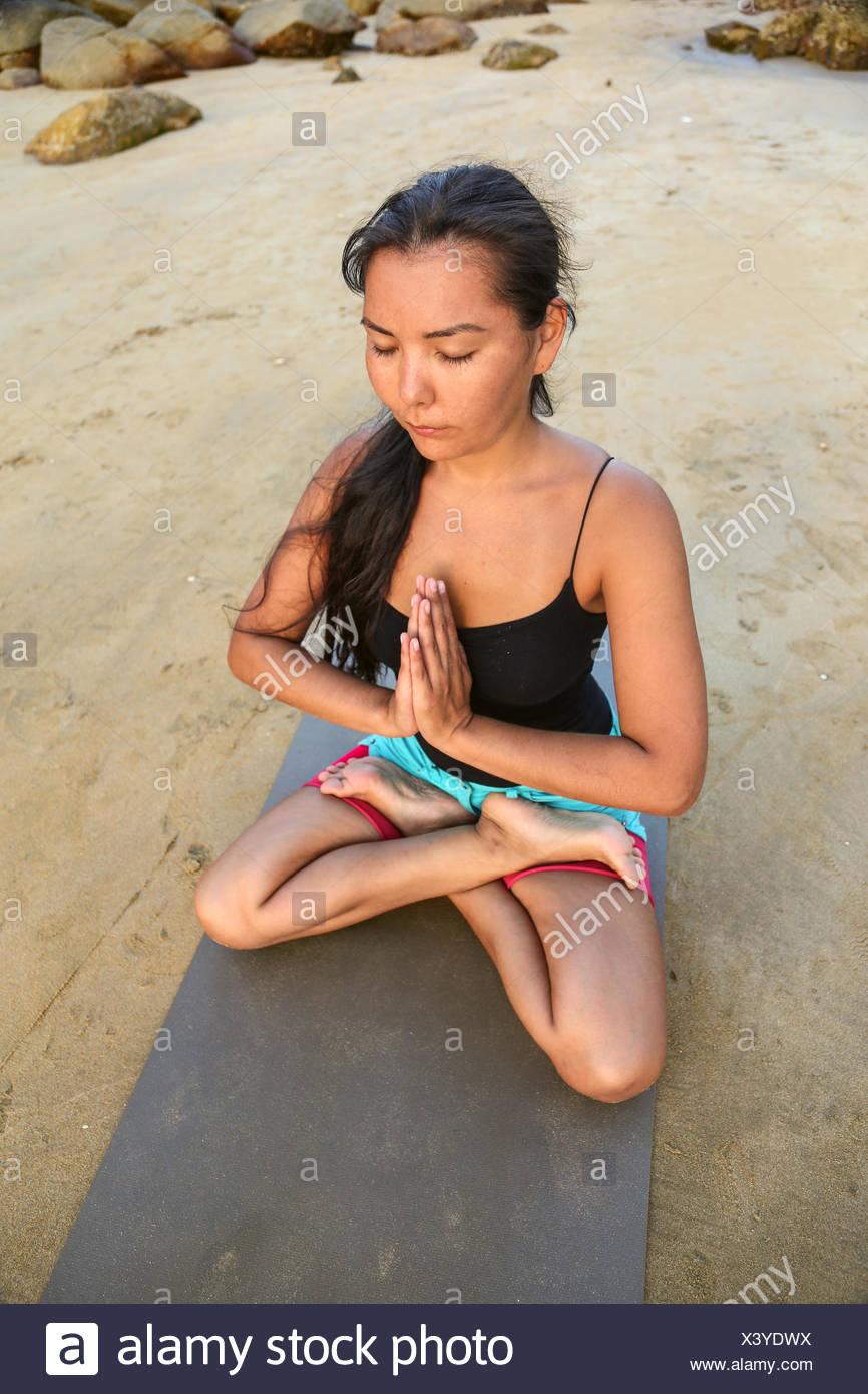 Beautiful woman doing yoga - Stock Image