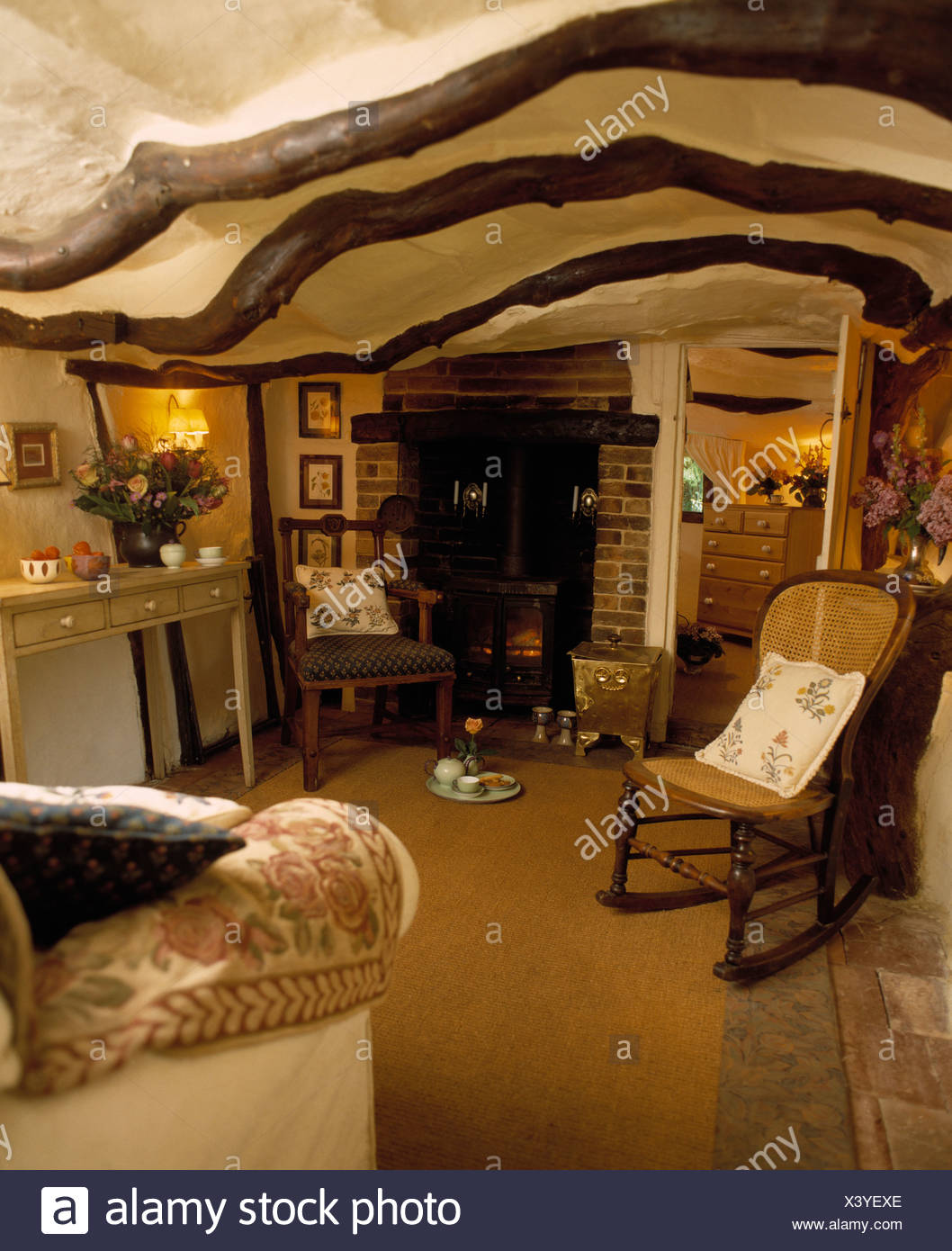 Cane-back rocking chair in small cottage living room with ...