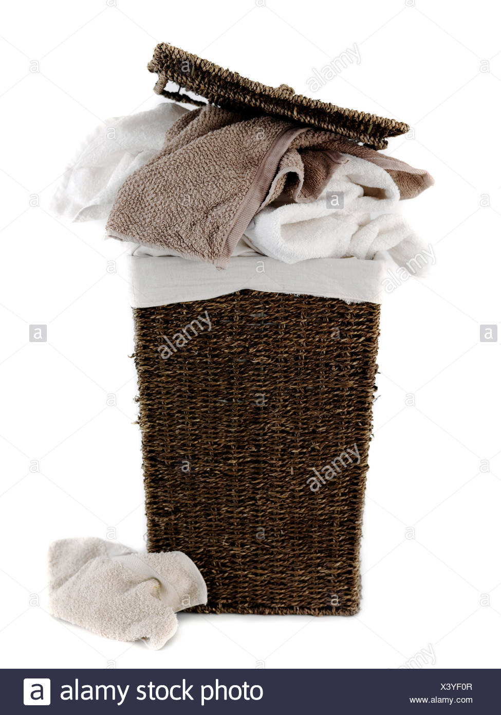 A laundry basket isolated against a white background - Stock Image