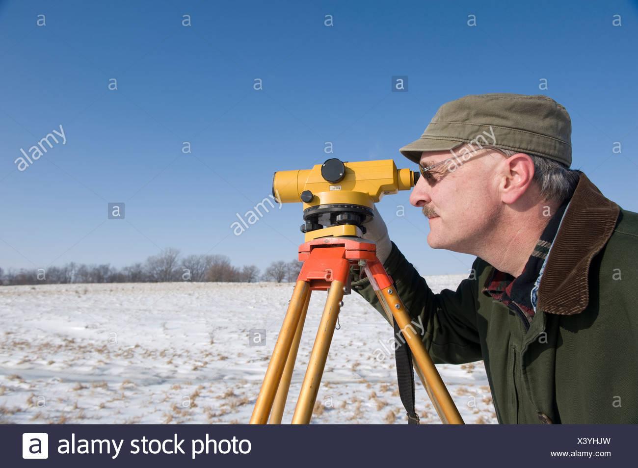 A man surveys a farm near Dunbar, Nebraska. Stock Photo