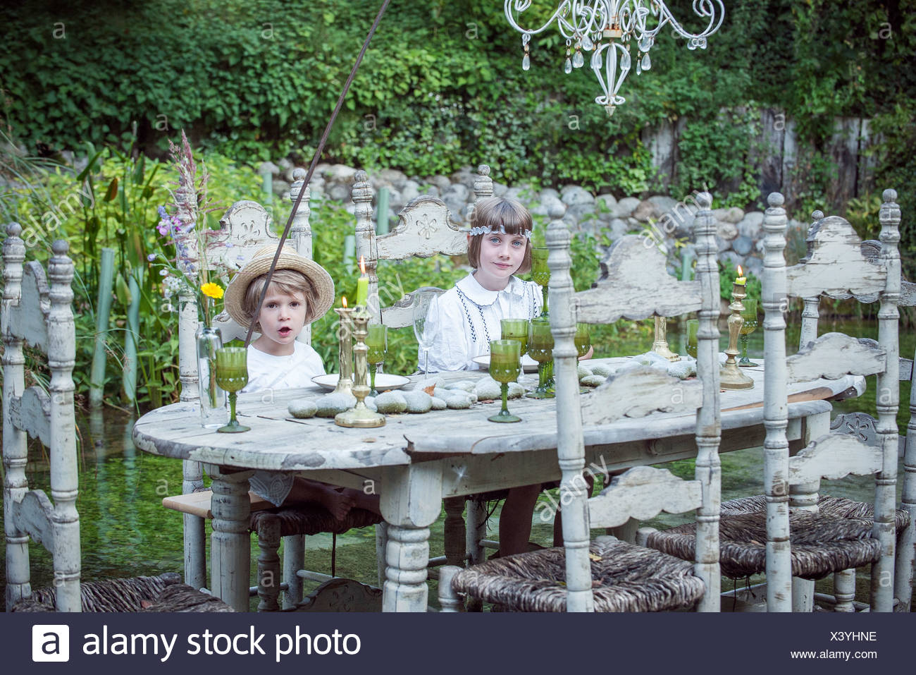 Children playing make-believe outdoors - Stock Image