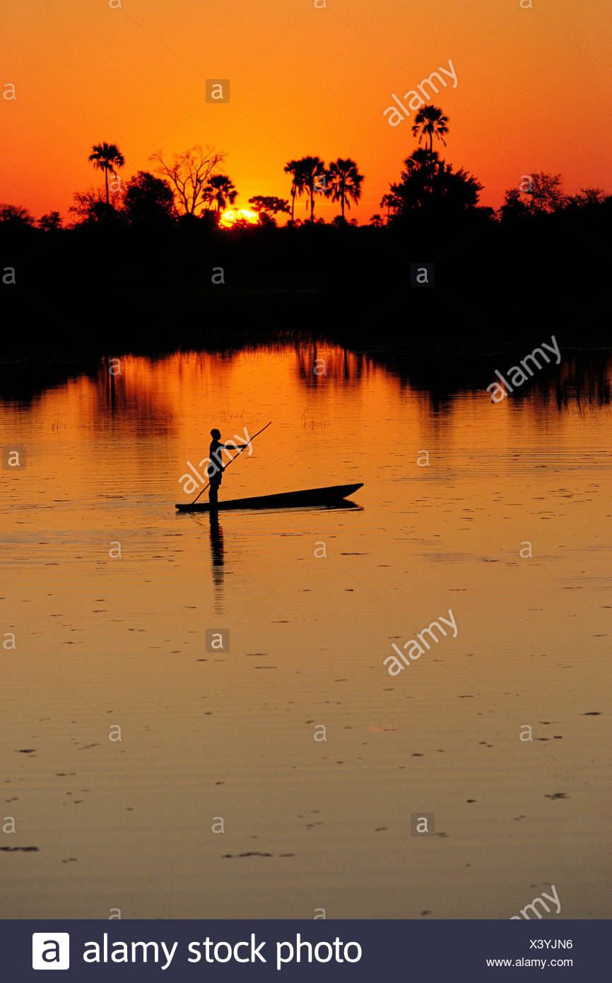 Person on a Boat Botswana, Africa - Stock Image