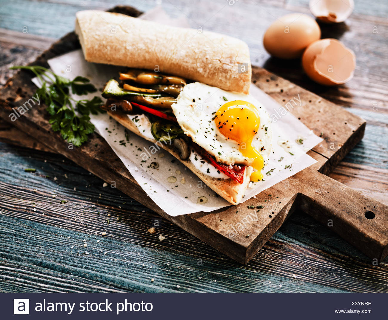 Sandwich with grilled vegetables and sunny side up egg - Stock Image
