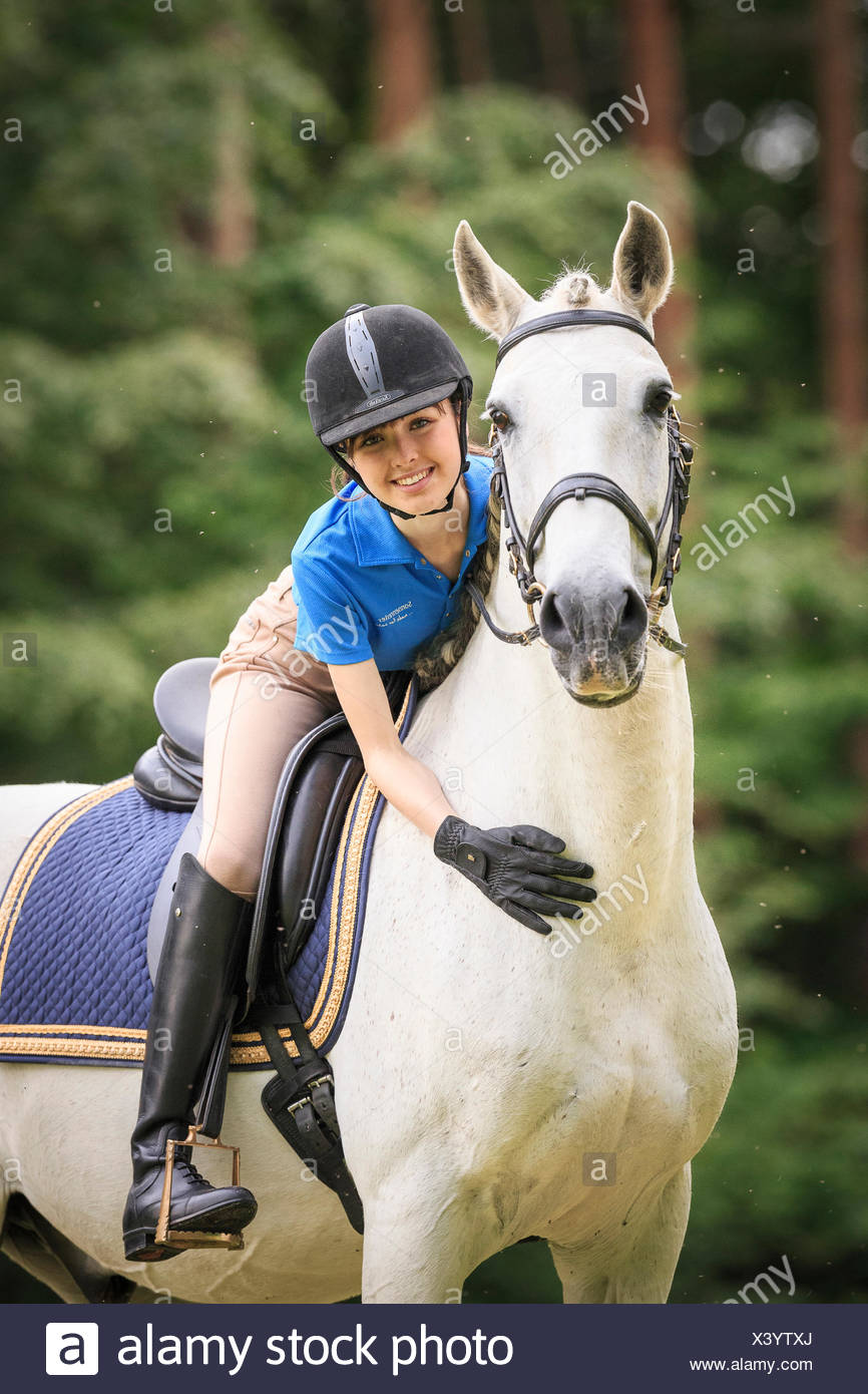 Lusitano. Rider fondling grey horse Austria - Stock Image