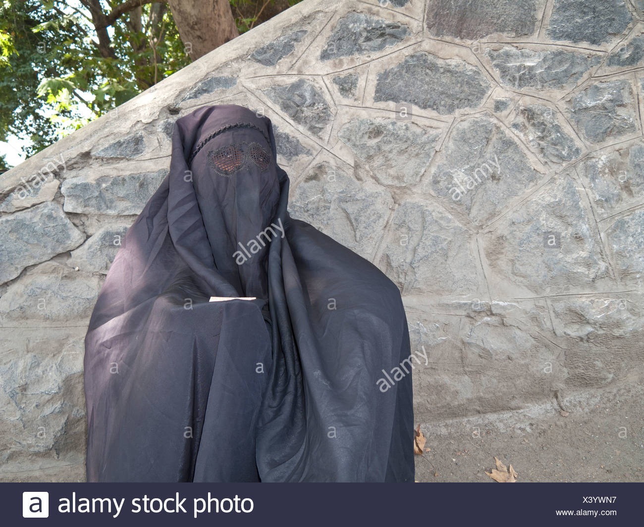 Muslim woman dressed in a burka, in traditional area of Srinagar, Jammu and Kashmir, India, Asia - Stock Image