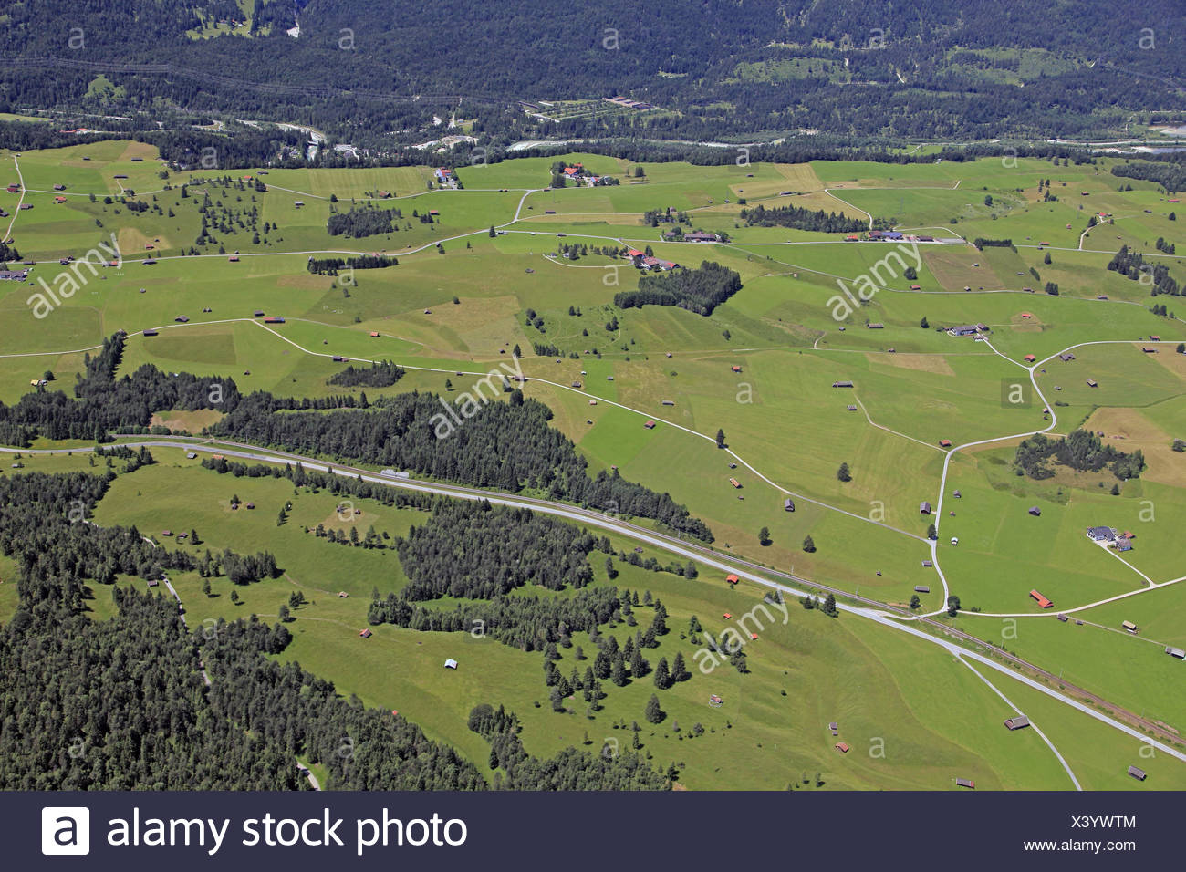 Germany, Upper Bavaria, Mittenwald, hump meadows, aerial shots, Bavaria, in Bavarian, groups trees, federal highway, ways, agrarian country, pastureland, barn, hay barn, farm, court groups, scenery, man-made landscape, aerial health resort, houses, Isar v - Stock Image