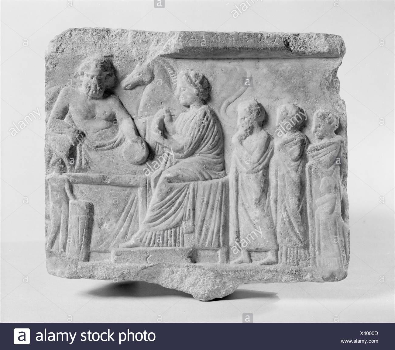Marble votive relief dedicated to a hero. Period: Late Classical; Date: late 4th century B.C; Culture: Greek, Attic; Medium: Marble; Dimensions: - Stock Image