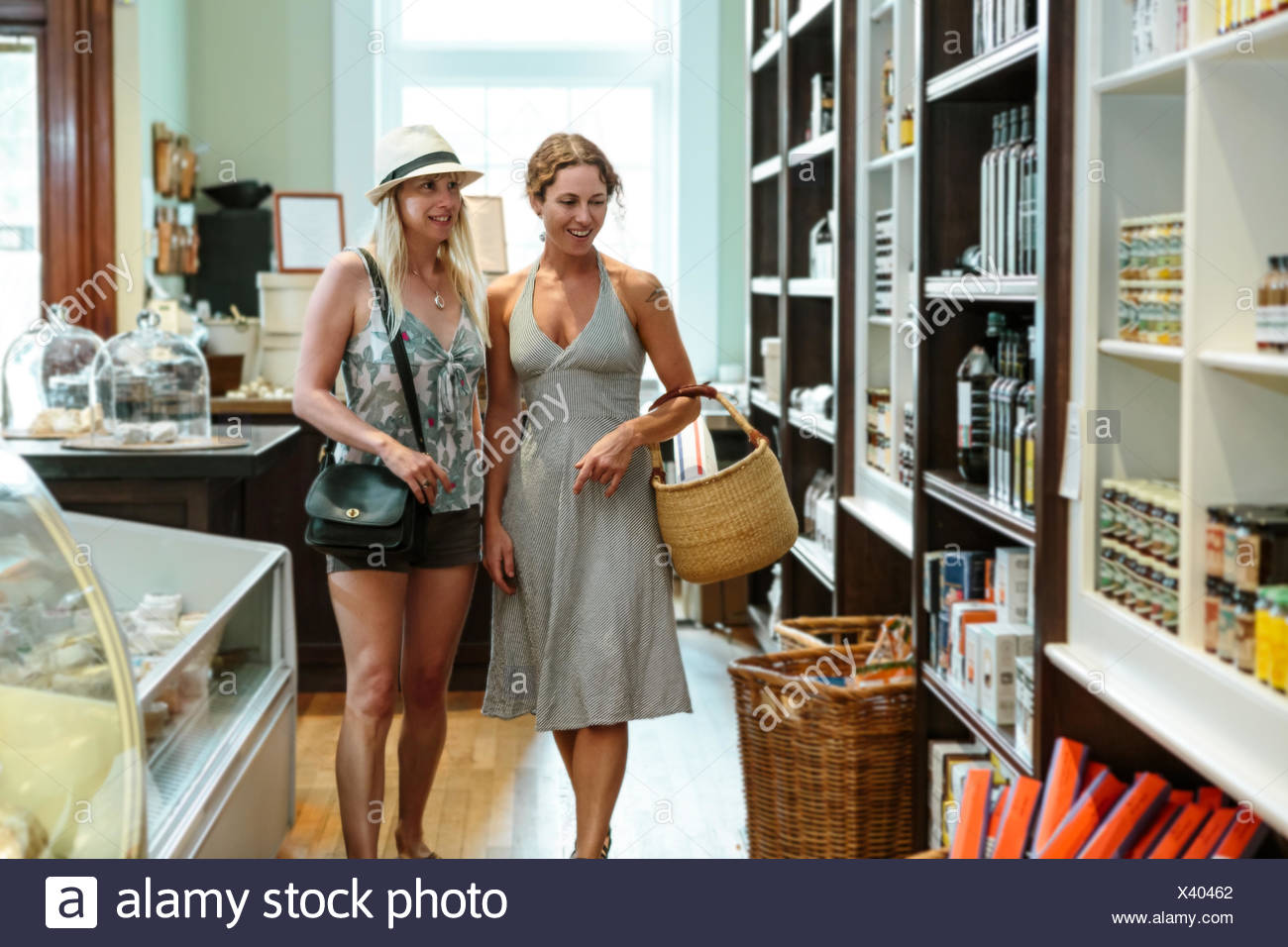 Two female friends browsing in organic grocery - Stock Image