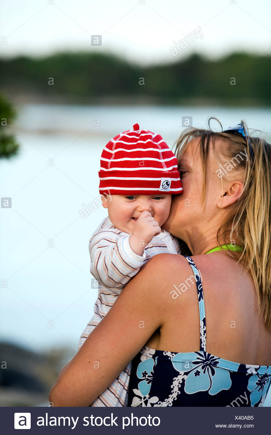Mother holding a baby Sweden. - Stock Image