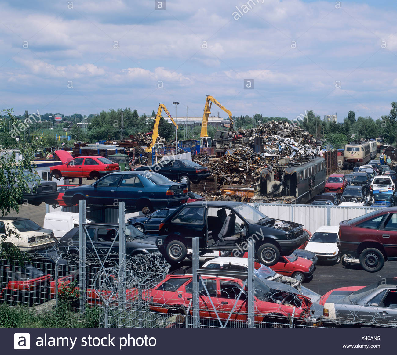 View of a scrap metal collection point, car chassis, pile of metal rubbish Stock Photo