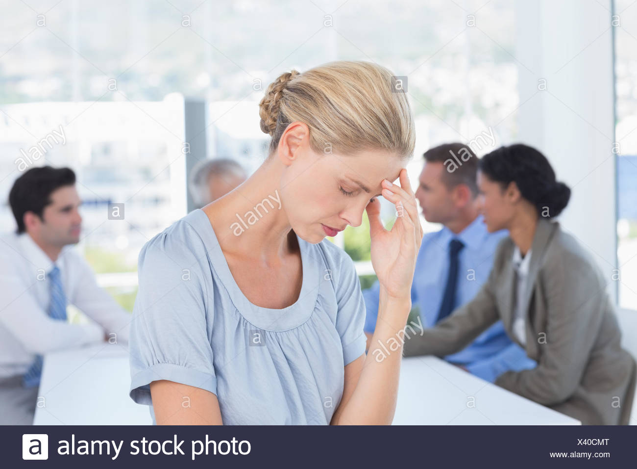 Disappointed businesswoman and her team - Stock Image