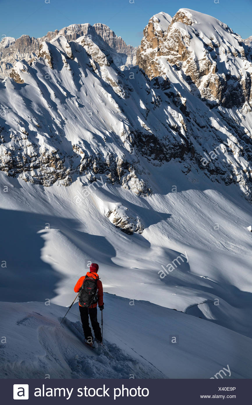 A mountaineer stand ready to ski downhill at 2490 meters at Forca Rossa. - Stock Image