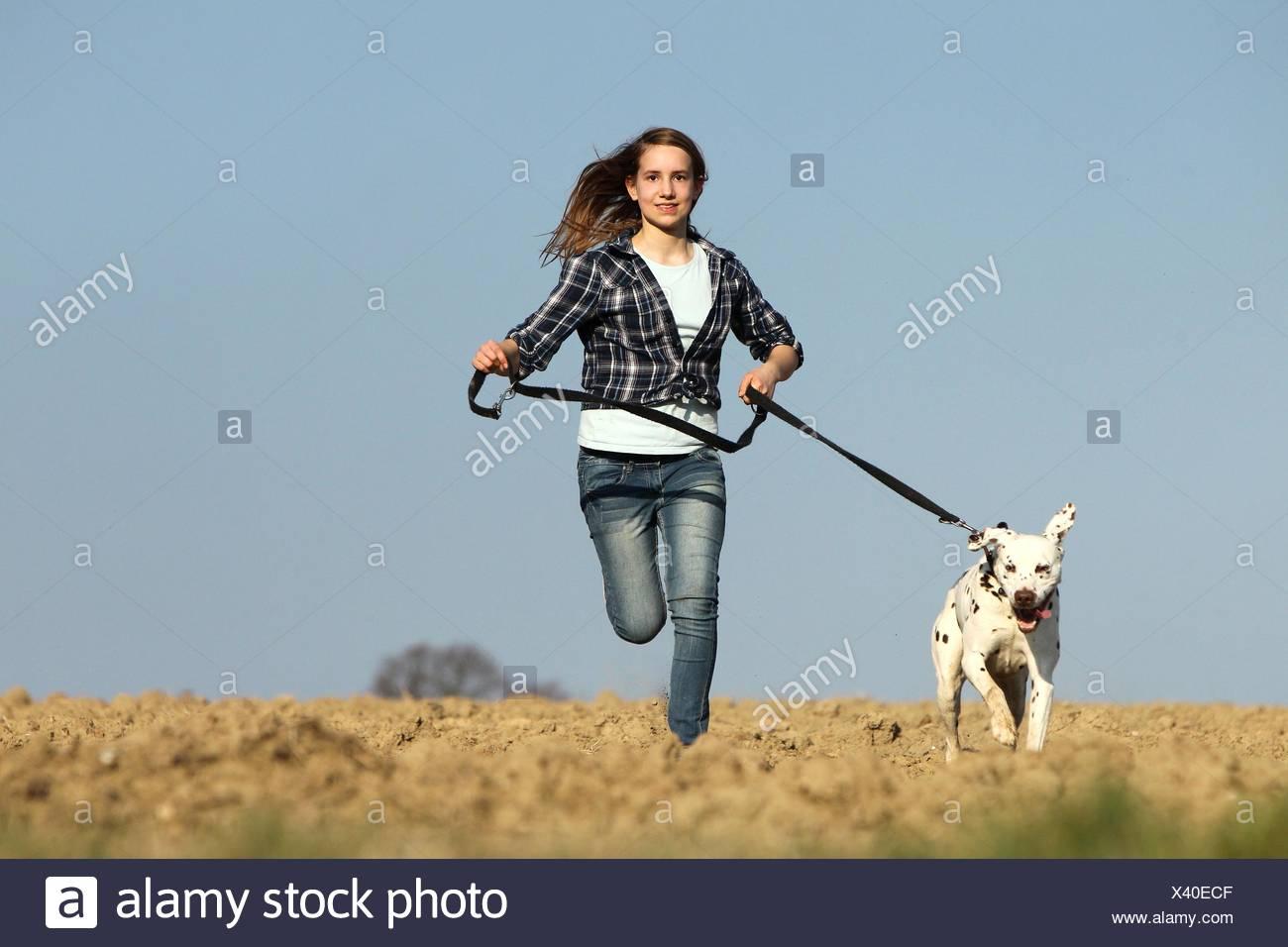 girl with Dalmatian - Stock Image