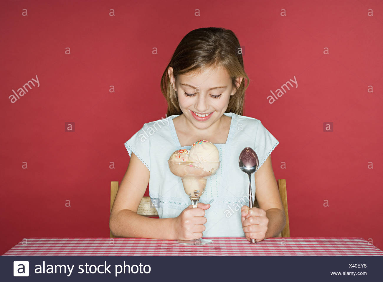 Girl about to eat ice cream - Stock Image