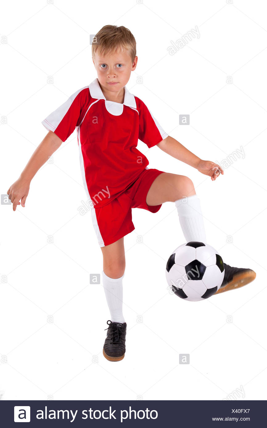 ball shot tricot young younger sport sports soccer football child sport sports ball portrait blank european caucasian active - Stock Image