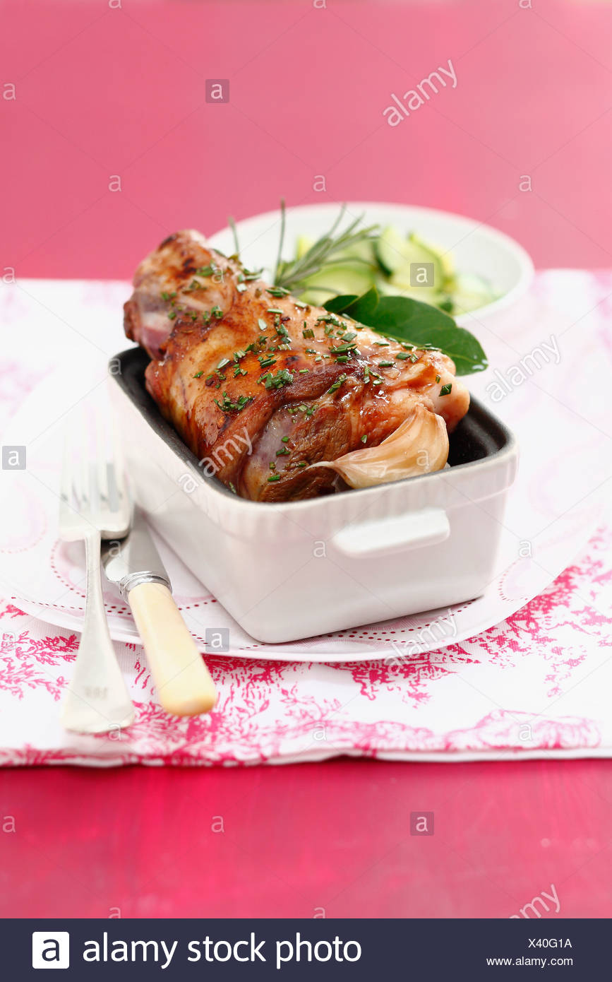 Oven-baked leg of lamb with rosemary and garlic - Stock Image