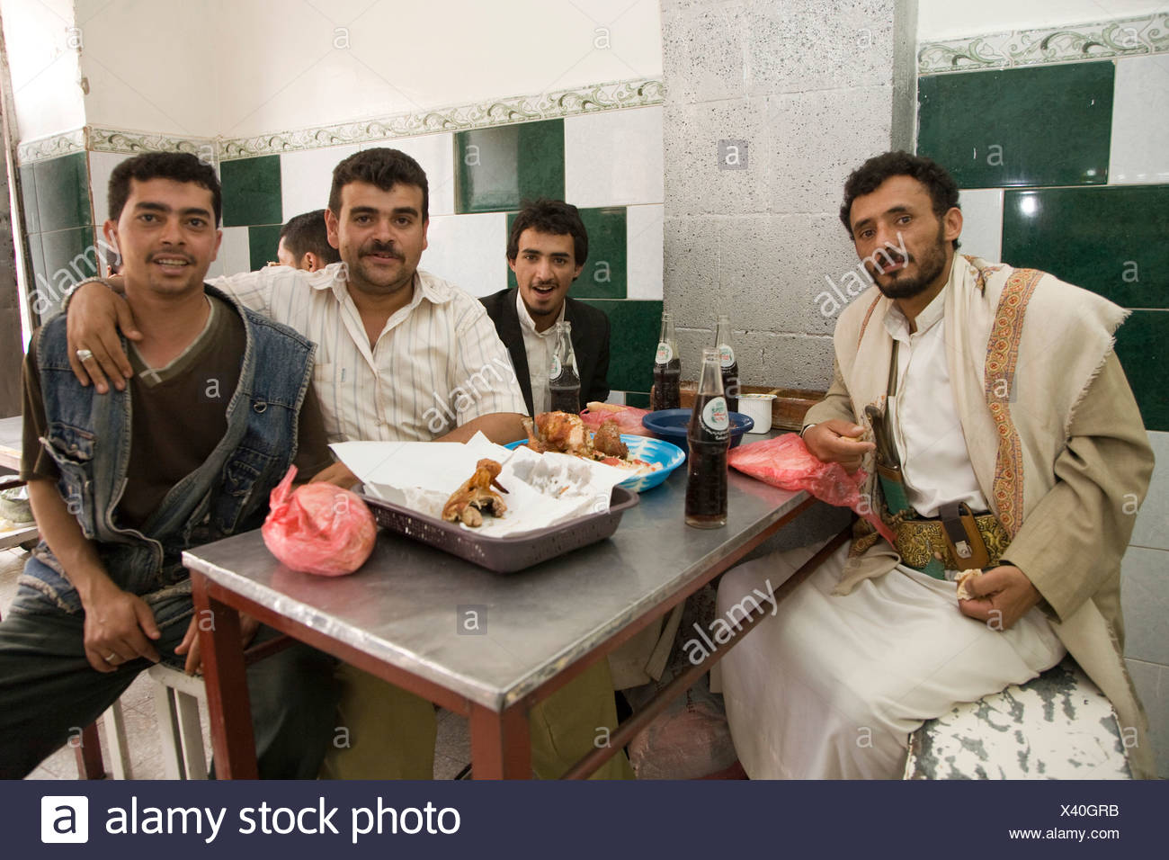 Men eating at a diner, San'a', Yemen, Middle East - Stock Image
