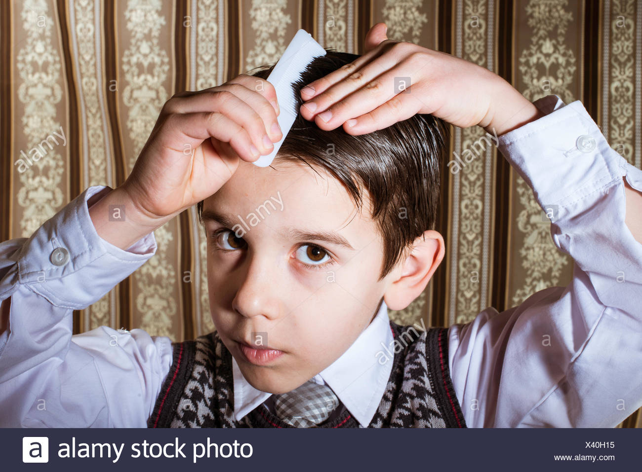 Child vintage clothes decided his hair. Close up shot - Stock Image