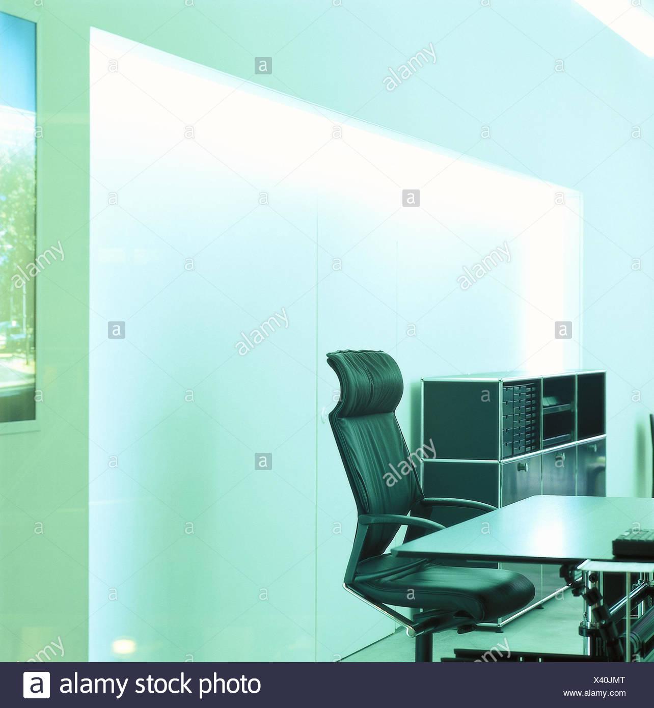 Office furnitures, modern, armchair, desk, swivelling, inside, office, office equipment, cupboard, office armchair, leather ball armchair, St. furniture, spectral filter, green - Stock Image