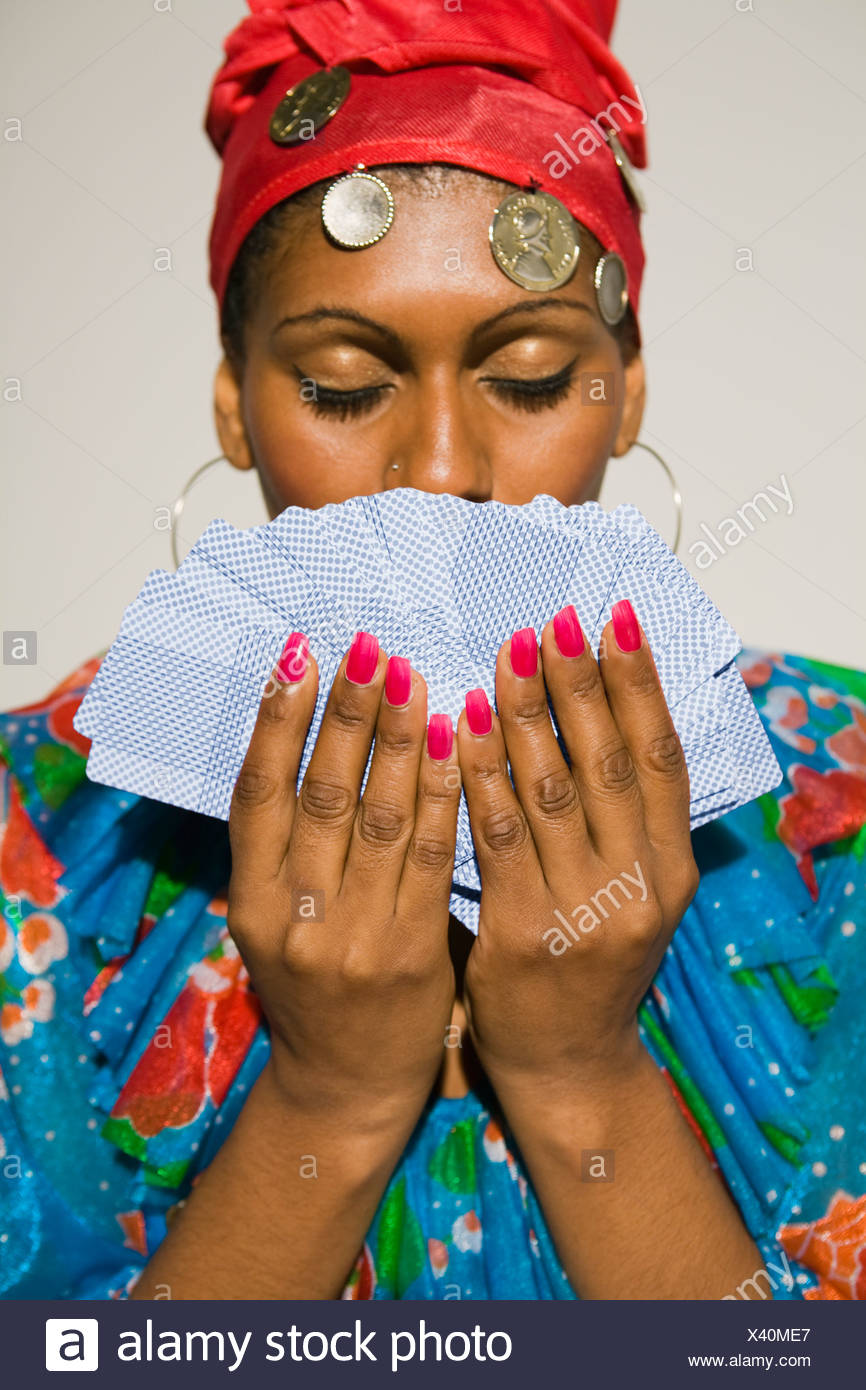 Close-up of a young woman holding tarot cards - Stock Image