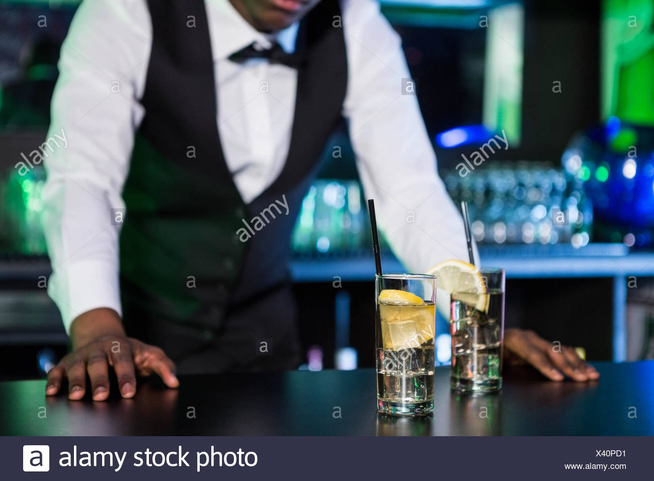 Two glasses of gin on bar counter - Stock Image