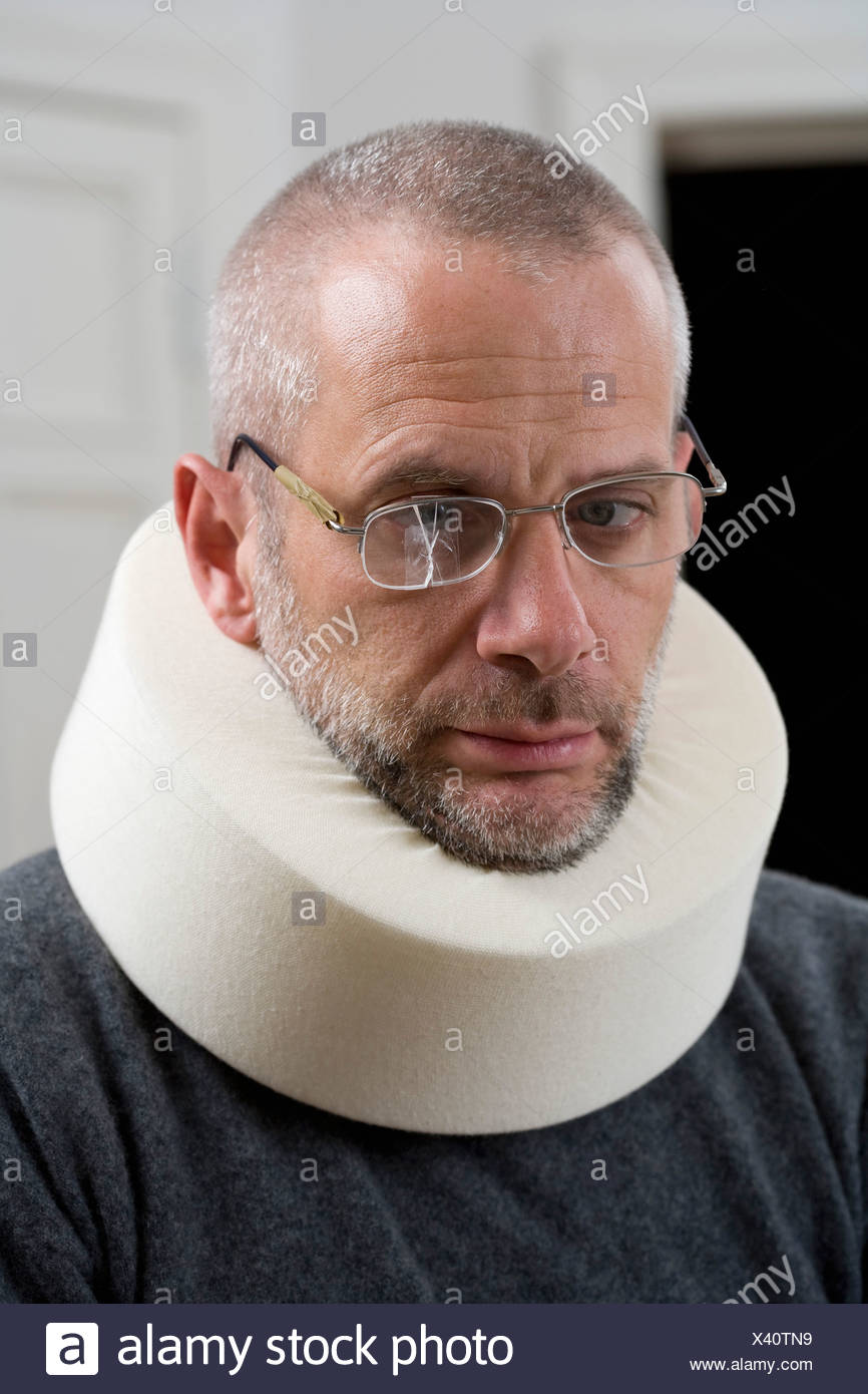 A man wearing a neck brace and cracked glasses Stock Photo