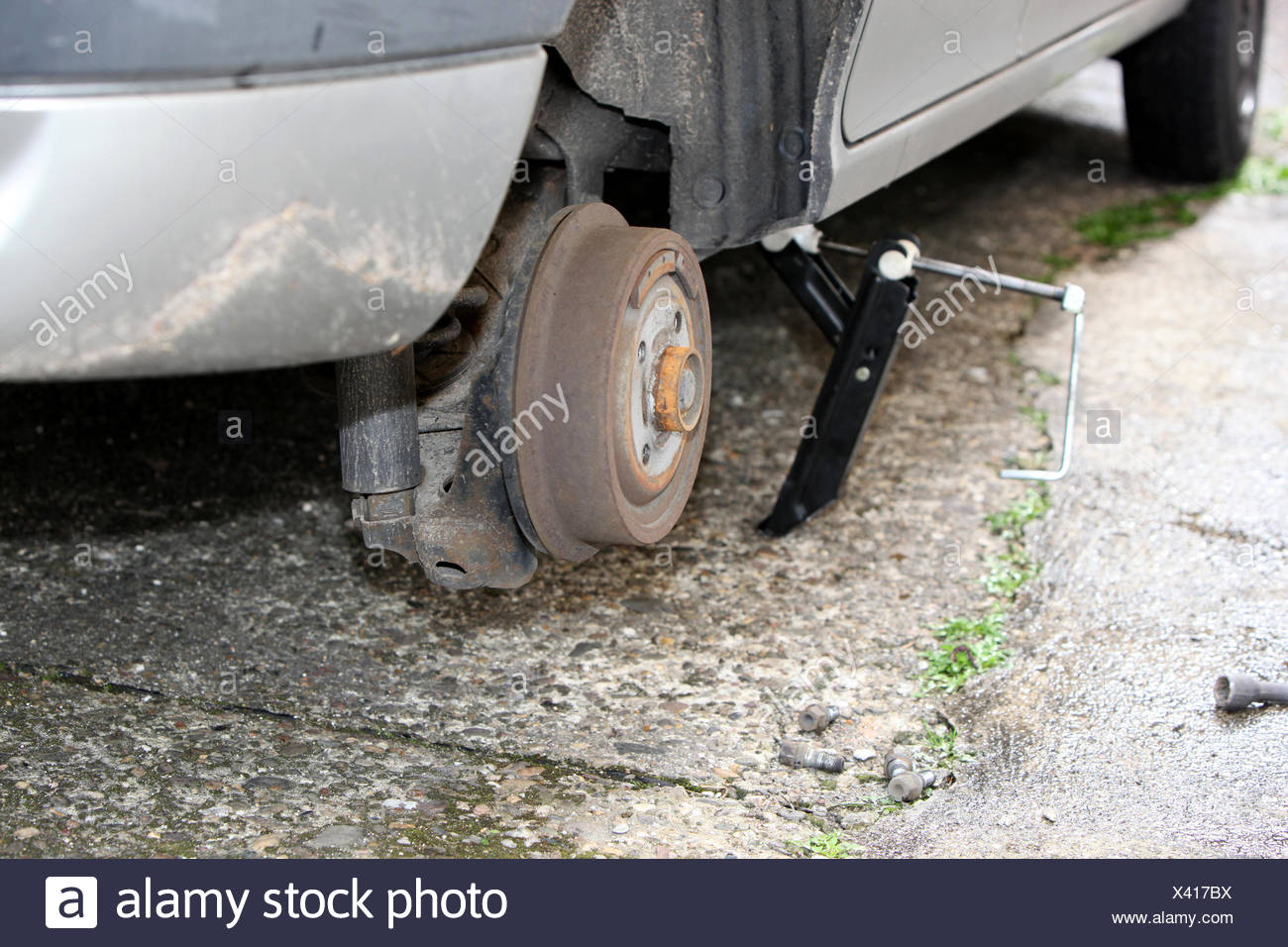 A car tire is changed - Stock Image