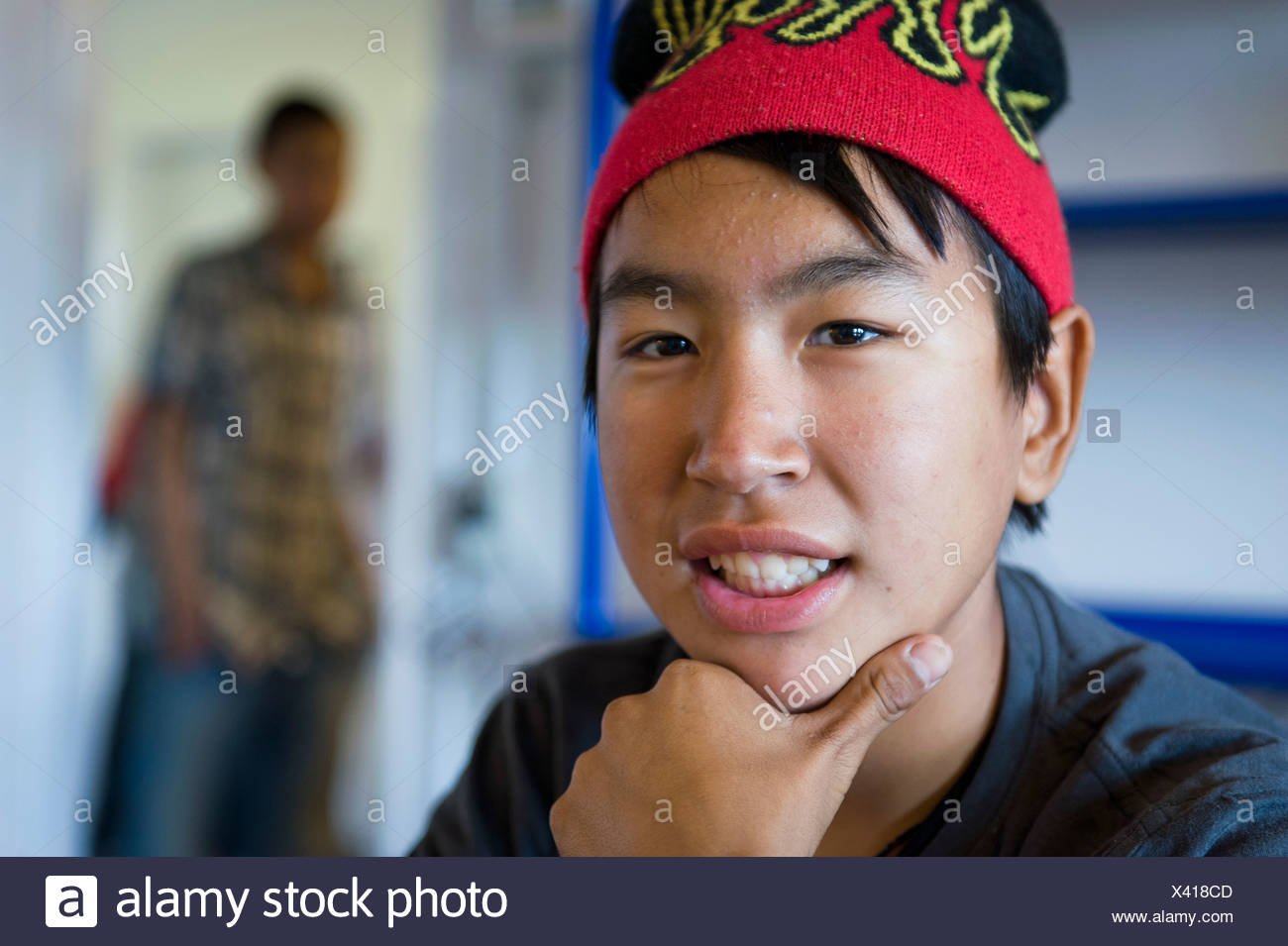 Inuit boy at the Community House, Inuit settlement of Tiniteqilaaq, Sermilik Fjord, East Greenland, Greenland - Stock Image