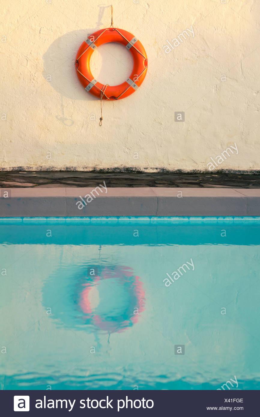 Spain, Canary Islands, La Palma, life saver hanging on wall behind swimming pool - Stock Image
