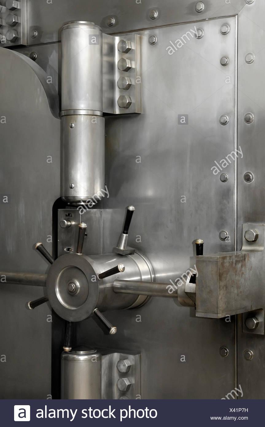 Stainless steel bank vault door locks and hinges - Stock Image