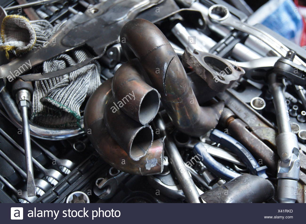 High Angle View Of Piston Amidst Work Tool In Garage - Stock Image