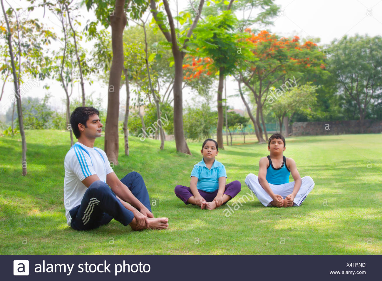 Family exercising in park - Stock Image