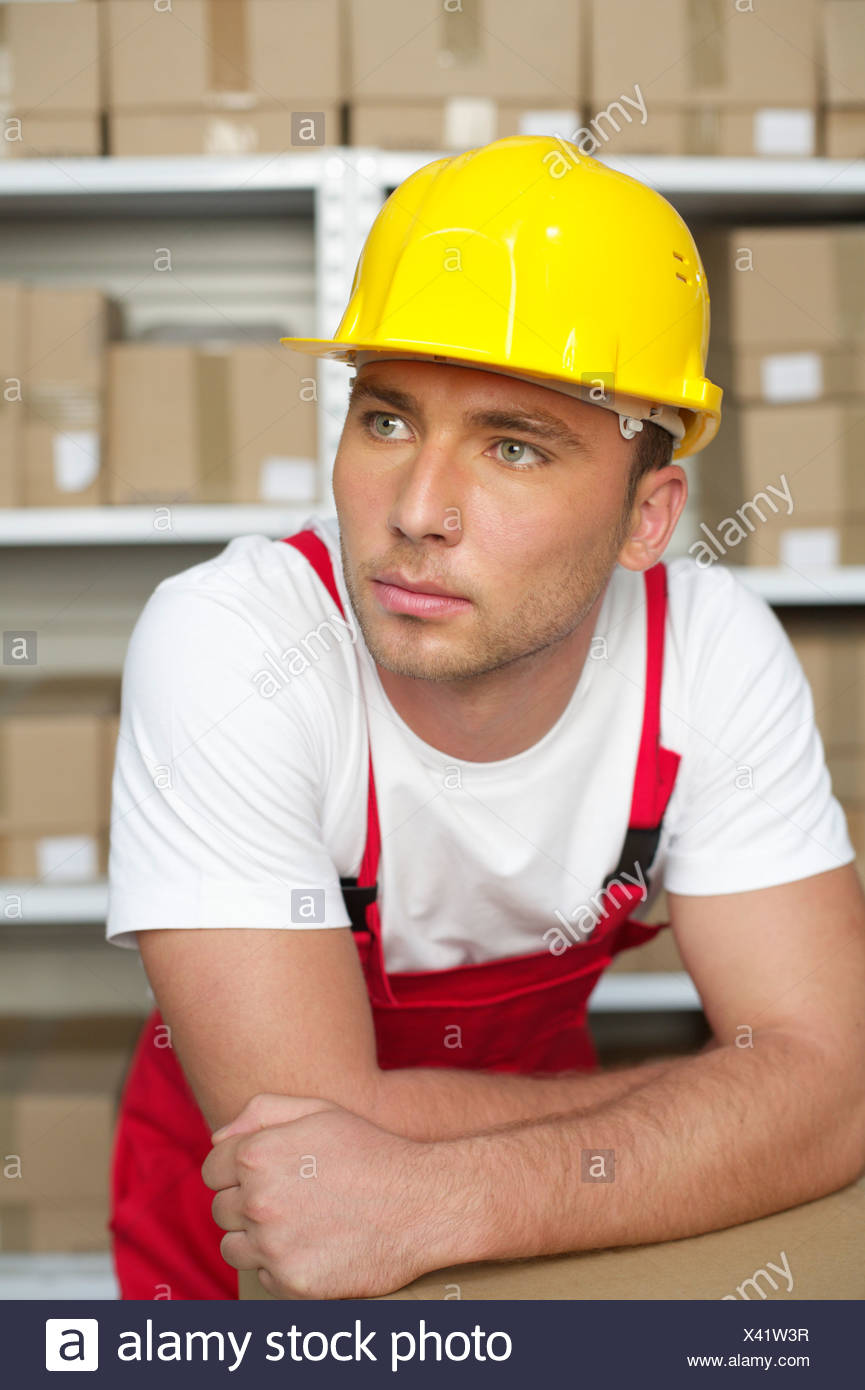 Portrait of a man wearing a hard hat - Stock Image