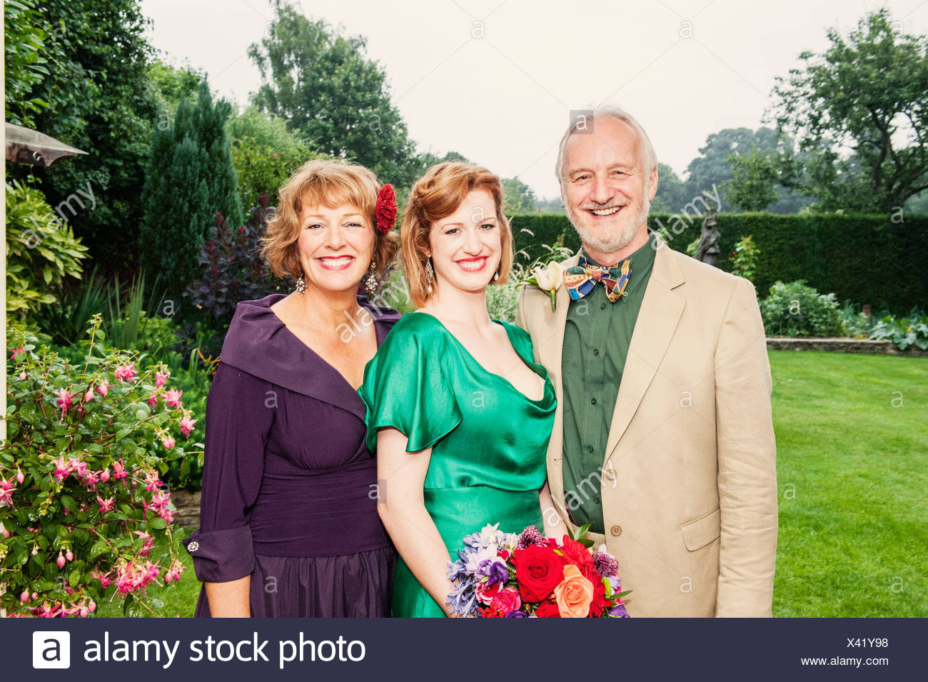 Portrait of newly married daughter with her parents - Stock Image