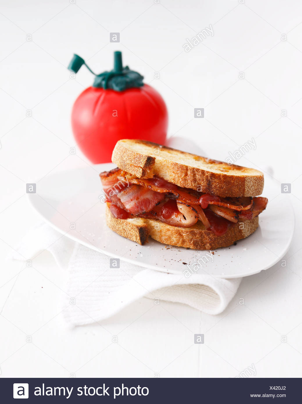 Bacon sandwich with tomato ketchup - Stock Image