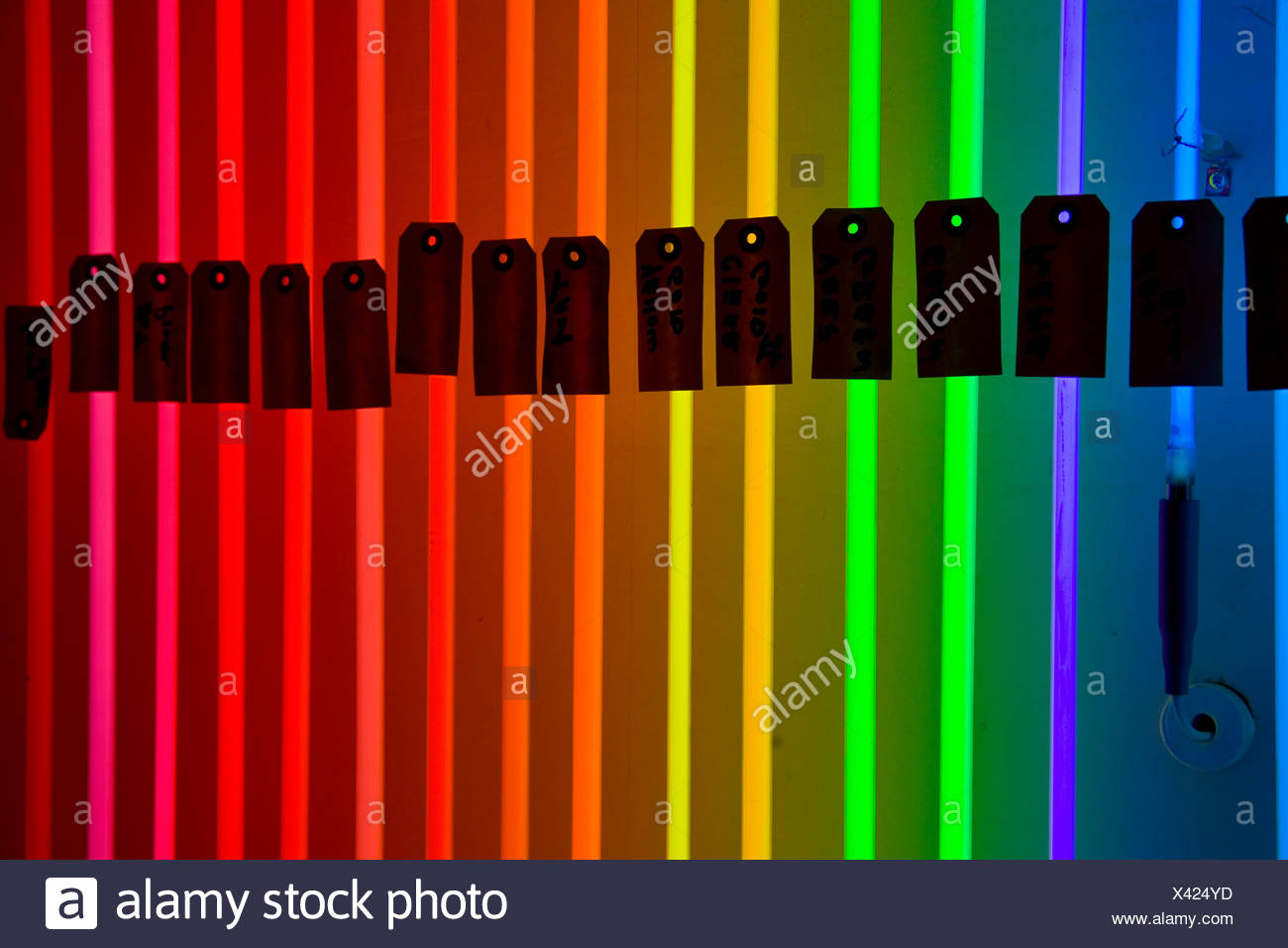 A glowing color spectrum of neon sample tubes at 'Desert Neon'. - Stock Image