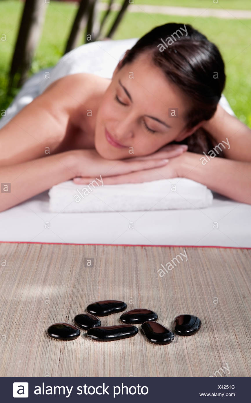 Woman lying on a massage table - Stock Image
