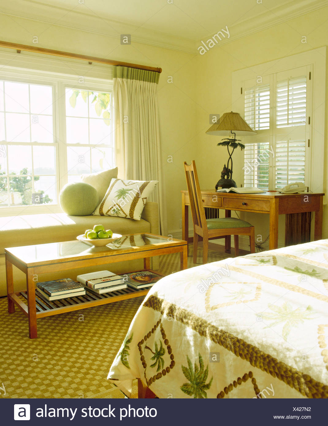 Picture of: Glass Topped Coffee Table In Front Of Sofa In Window Of Bermudan Bedroom With Decorative Bed Cover And Louvre Shutters Stock Photo Alamy