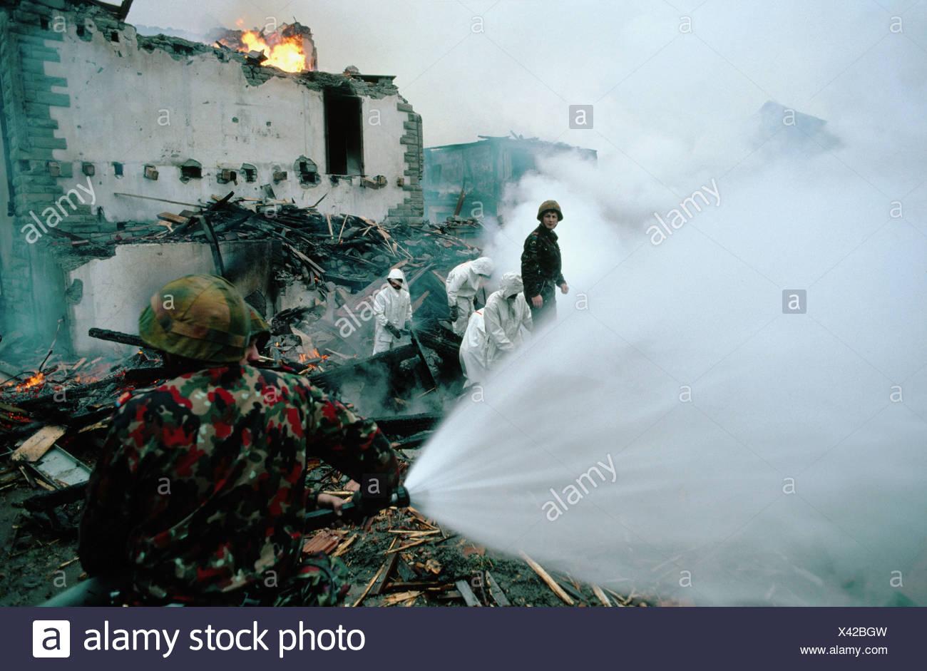 burn house home extinguishing fire brigade department fire-fighting work military Switzerland Europe pract - Stock Image