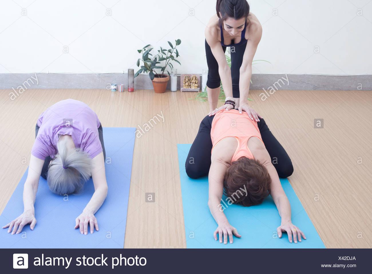 Women in child's pose - Stock Image