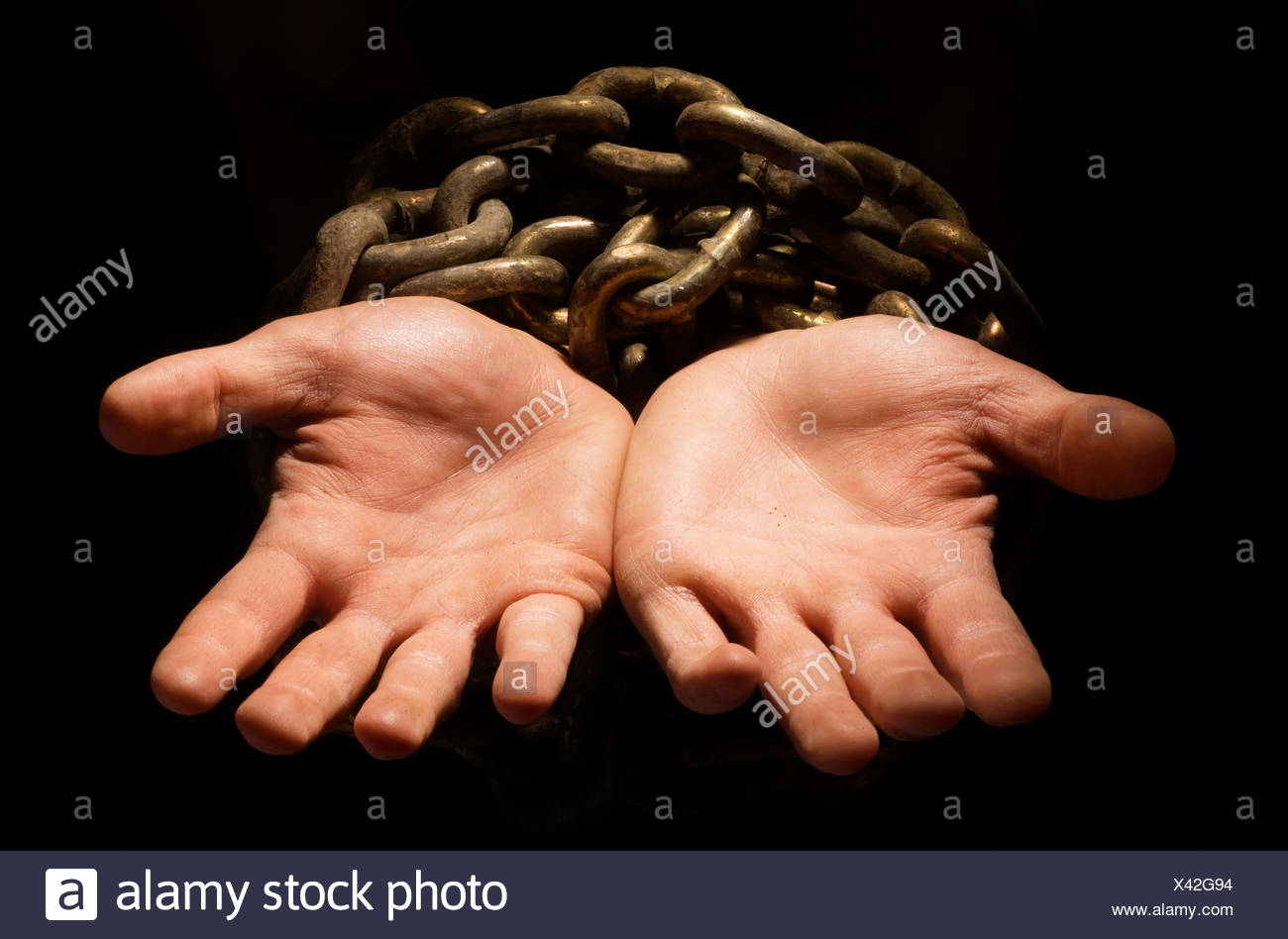 Chained hands - Stock Image