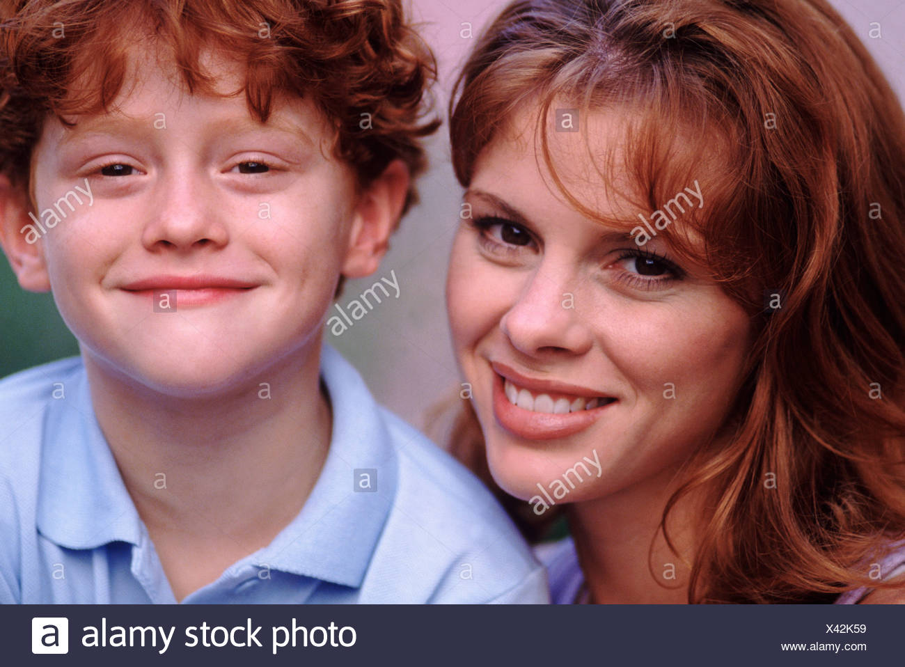 Portrait of a mother an her cute red headed son - Stock Image