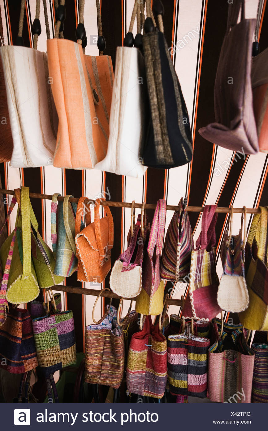 Close-up of hand bags and purses hanging at a market stall - Stock Image
