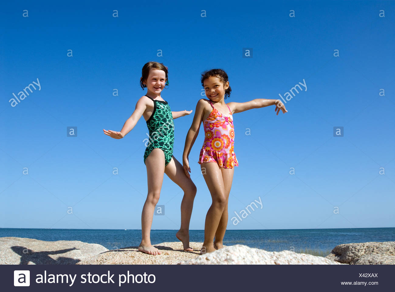 Girl friends hamming it up at the beach, Paines Beach, Cape Cod, MA - Stock Image