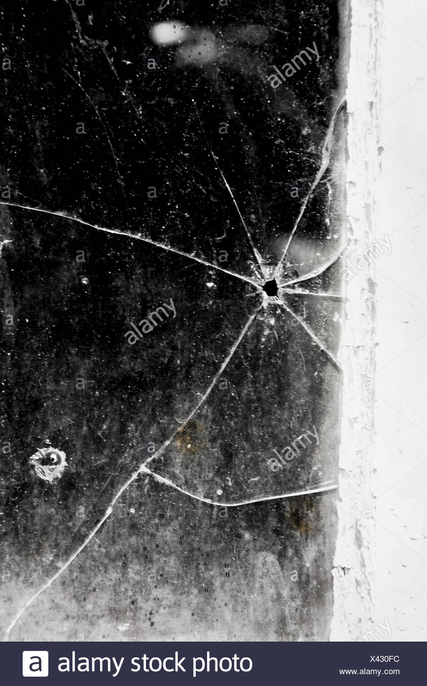 Bullet Hole On Glass Window - Stock Image
